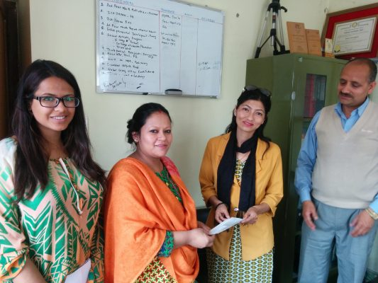 (Acknowledgement to donors 2) The collected amount being handed to founder of SSDRC, Ms Sabita Upreti(right)by Ms. Ishu Subba, Executive Director (left) of ICA Nepal.